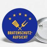Ansteck-Button mit Motiv Bratenschutz-Aufsicht in Blau / Gelb